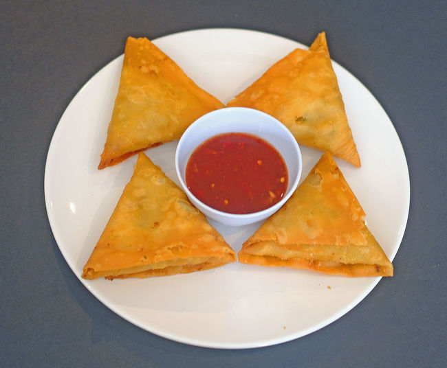 crispy chicken samosa with sauce on white plate Appetizer Close-up Crispy Chicken Samosa DIP Food Food And Drink Freshness Fried High Angle View Indoors  Nacho Chip No People Plate Ready-to-eat Sauce Savory Sauce Serving Size Snack Still Life Table Tomato Sauce Tortilla Chip White Plate With Food