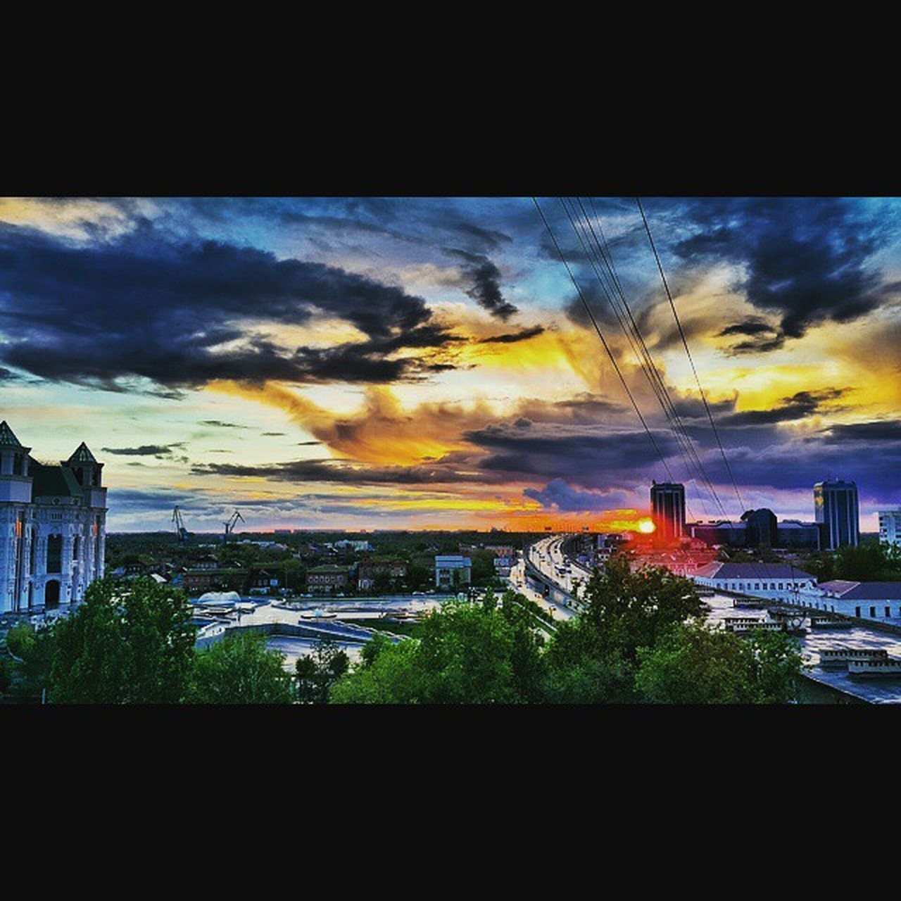 architecture, cloud - sky, built structure, building exterior, sky, dramatic sky, city, sunset, no people, outdoors, cityscape, tree, nature, travel destinations, skyscraper, urban skyline, scenics, multi colored, beauty in nature, day