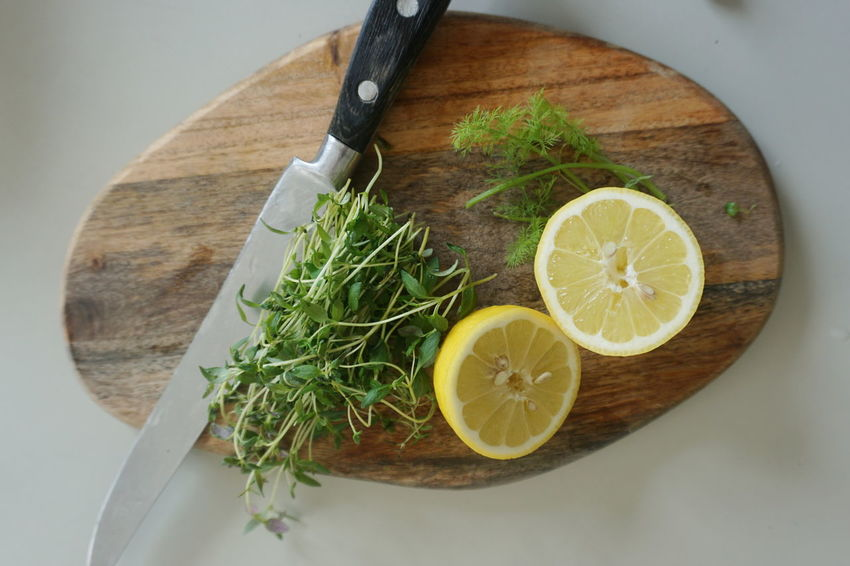dill, thyme and lemon Lemon Herbs Herbst Dill Cutting Board Woodboard Wood Board Herb Lime Citrus Fruit SLICE Sour Taste Fruit Wood - Material High Angle View Directly Above Rosemary Seasoning Thyme Halved