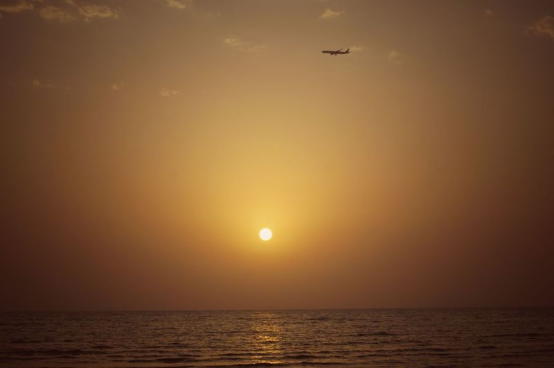 Scenics Sunset Sun Sea Horizon Over Water Sky Journey Travel Silhouette Flying Nature Landscape Idyllic Tranquil Scene Tranquility Water No People Outdoors Sunlight The Week On EyeEm Eyeem Philippines Doha City Doha,Qatar A6000photography Seascapes