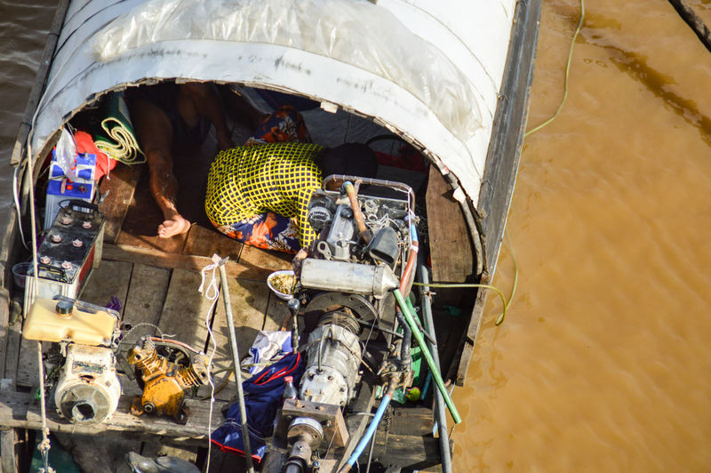 EyeEm Selects Day Nautical Vessel Adult Multi Colored One Man Only Outdoors One Person Only Men People High Angle View Travel Traveler Kampot, Cambodia People Living On A Boat Boat Life Lifestyle ASIA Asian Culture Different Perspective Light And Shadow Travel Destinations Summer Rainy Season
