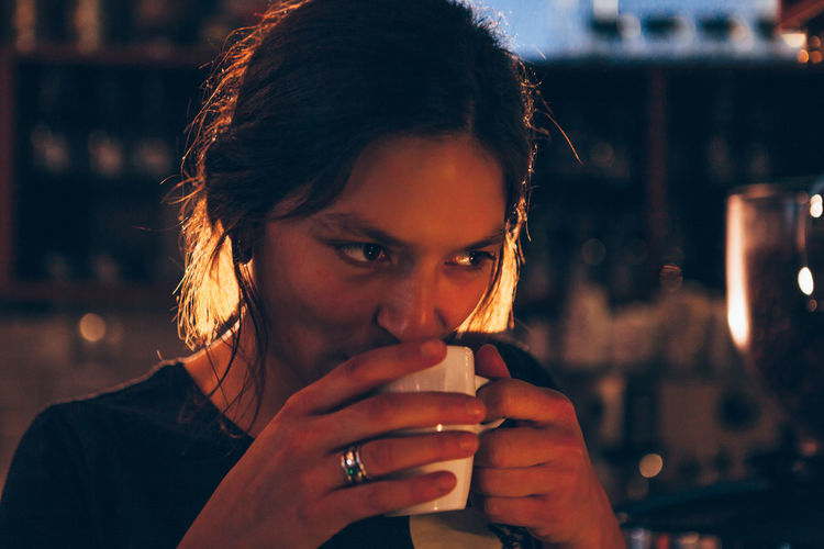 Close-up Coffee Cup Drinking Enjoying Life Focus On Foreground Headshot Lifestyles Looking At Camera Night One Person Outdoors Portrait Real People Relax Young Adult Young Women EyeEmNewHere The Portraitist - 2018 EyeEm Awards