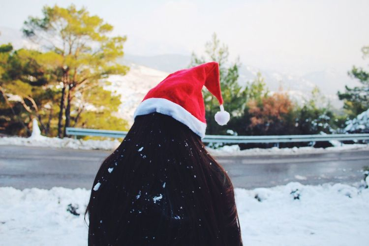 Mrs. Santa Claus Winter Snow Cold Temperature Real People Focus On Foreground Weather Outdoors One Person Day Lifestyles Nature Warm Clothing Leisure Activity Tree Sky