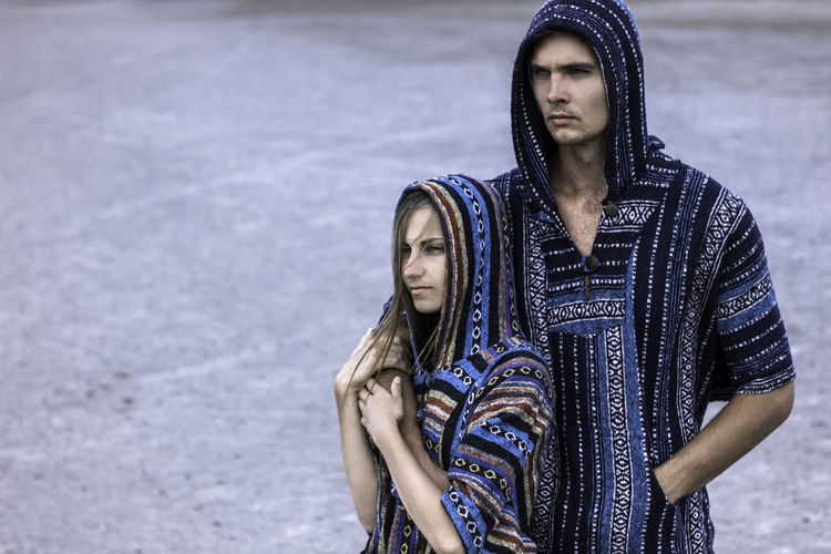 Beautiful young loving couple in traditional poncho clothes. Shooting in the desert. Photo with daylight. Three quarters length portrait. Couple Love Relationship Traditional Clothing Beautiful Woman Casual Clothing Clothing Couple - Relationship Day Focus On Foreground Front View Leisure Activity Lifestyles Looking At Camera Outdoors People Poncho Portrait Real People Standing Teenager Traditional Clothing Women Young Adult Young Women Summer Road Tripping The Portraitist - 2018 EyeEm Awards The Photojournalist - 2018 EyeEm Awards The Still Life Photographer - 2018 EyeEm Awards The Traveler - 2018 EyeEm Awards The Great Outdoors - 2018 EyeEm Awards The Creative - 2018 EyeEm Awards The Fashion Photographer - 2018 EyeEm Awards The Street Photographer - 2018 EyeEm Awards Love Is Love