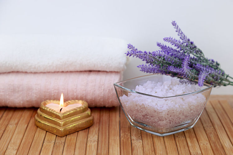 sea salt on a wooden table in the bathroom, concept - body care Nobody No People Body Care Skin Care Rustic Bath Candle Natural Pink Salt Wellness Bathroom Beauty Care Crystal Freshness Health Healthy Indoors  Ingredient Mineral Organic Pampering Purple Sea Spa Towel Towels Treatment White Wooden
