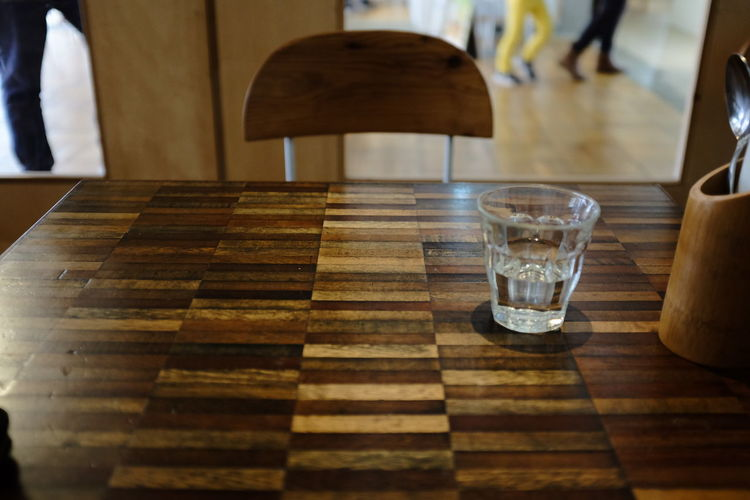 Drinking Glass On Wooden Table At Restaurant