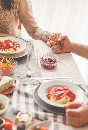 Food Food And Drink Human Hand Freshness Hand Plate Real People Table Indoors  Women People Adult Holding Lifestyles Two People Selective Focus Couple Holding Hands Lunch Vertical Praying Italian Food Love Unrecognizable Person