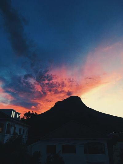 Dramatic sunset, Cape Town. Architecture Beauty In Nature Building Exterior Built Structure Clouds And Sky Day House Mountain Nature No People Outdoors Silhouette Sky Sunset Sunsets