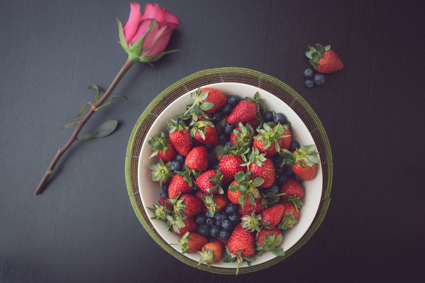 Strawberries and Blueberries in a white bowl with a pink rose on a black table Black Background Pink Rose Romantic Berry Fruit Black Background Blueberry Bowl Close-up Directly Above Flower Food Food And Drink Freshness Fruit Healthy Eating Healthy Lifestyle High Angle View Indoors  No People Raspberry Red Strawberry Sweet Table Tasty