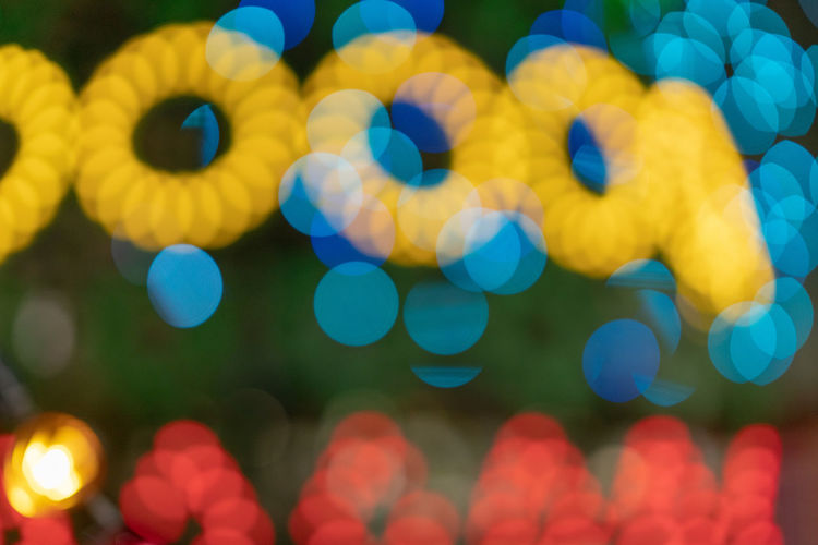 Defocused Illuminated No People Multi Colored Night Glowing Backgrounds Full Frame Lens Flare Close-up Light - Natural Phenomenon Shape Yellow Circle Abstract Geometric Shape Pattern Selective Focus Outdoors Lighting Equipment Light Festival