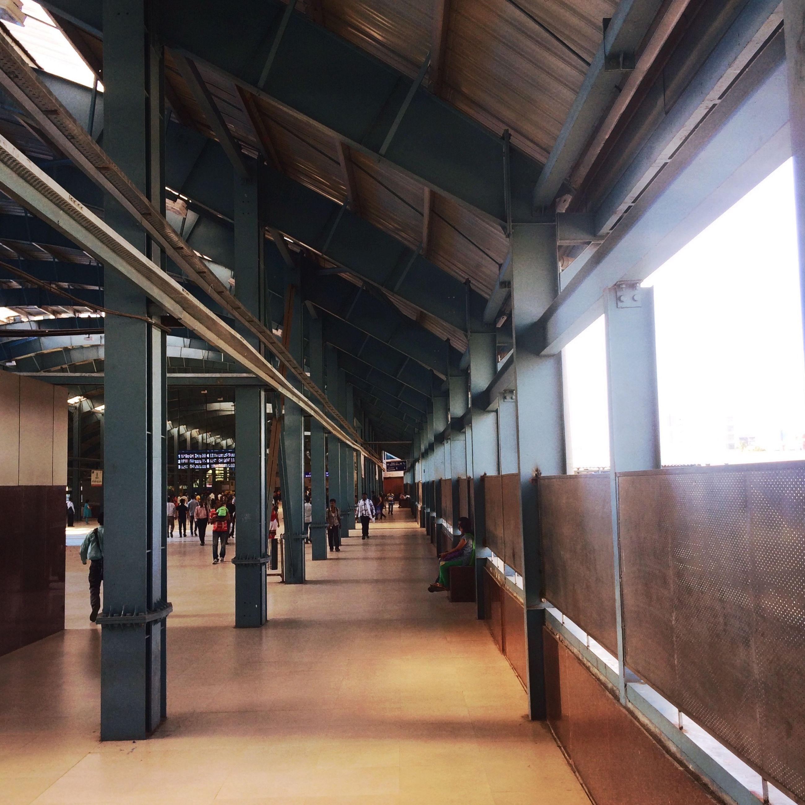 indoors, architecture, empty, built structure, corridor, in a row, the way forward, ceiling, absence, diminishing perspective, architectural column, flooring, chair, narrow, column, sunlight, day, repetition, no people, vanishing point