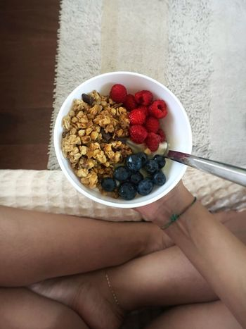 EyeEm Breakfast Club Healthy Eating Breakfast Human Hand Fruit Bowl Food Food And Drink Human Body Part Raspberry Berry Fruit Freshness Healthy Lifestyle Granola One Person Lifestyles Breakfast Cereal Blueberry Indoors  Holding Table Breakfast ♥ Breakfast LoveFood Foodporn