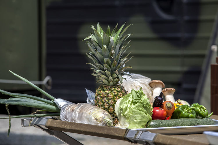 Various Fruits And Vegetables On Table During Camping