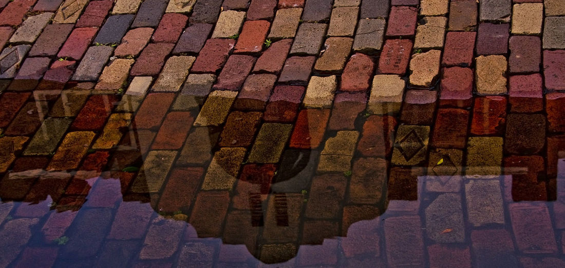 Brick Wall Close-up Coble Stones Full Frame Outdoors Reflections In The Water Street Photography Street Reflections