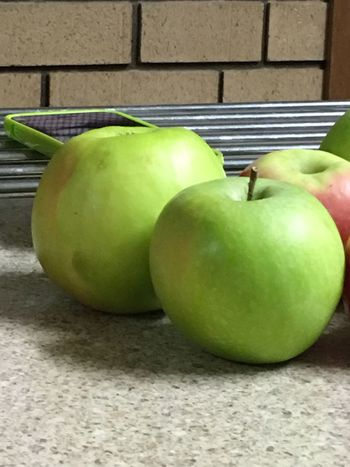 An apple among apples 🍎😆 Fruit Apple - Fruit Granny Smith Apple Green Color Still Life IPhone