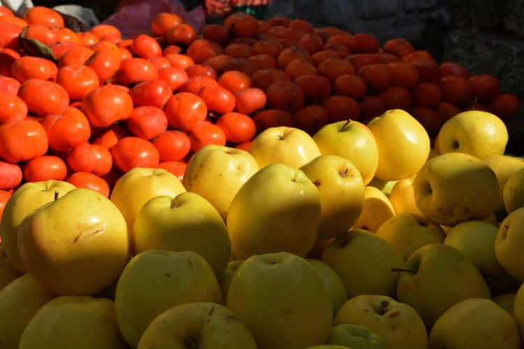 Apples And Tomatoes For Sale At Market Stall