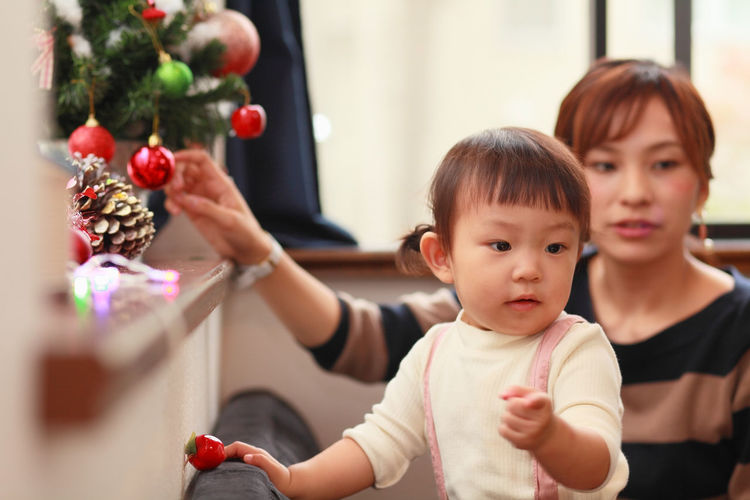 Asian  Baby Christmas Home Home Sweet Home Japan Japanese  Mother Bangs Childhood Christmas Decoration Christmas Ornament Christmas Tree Cute Day Girl Indoors  Lifestyles Lovely People Togetherness Women Young Adult Young Women This Is Family Holiday Moments