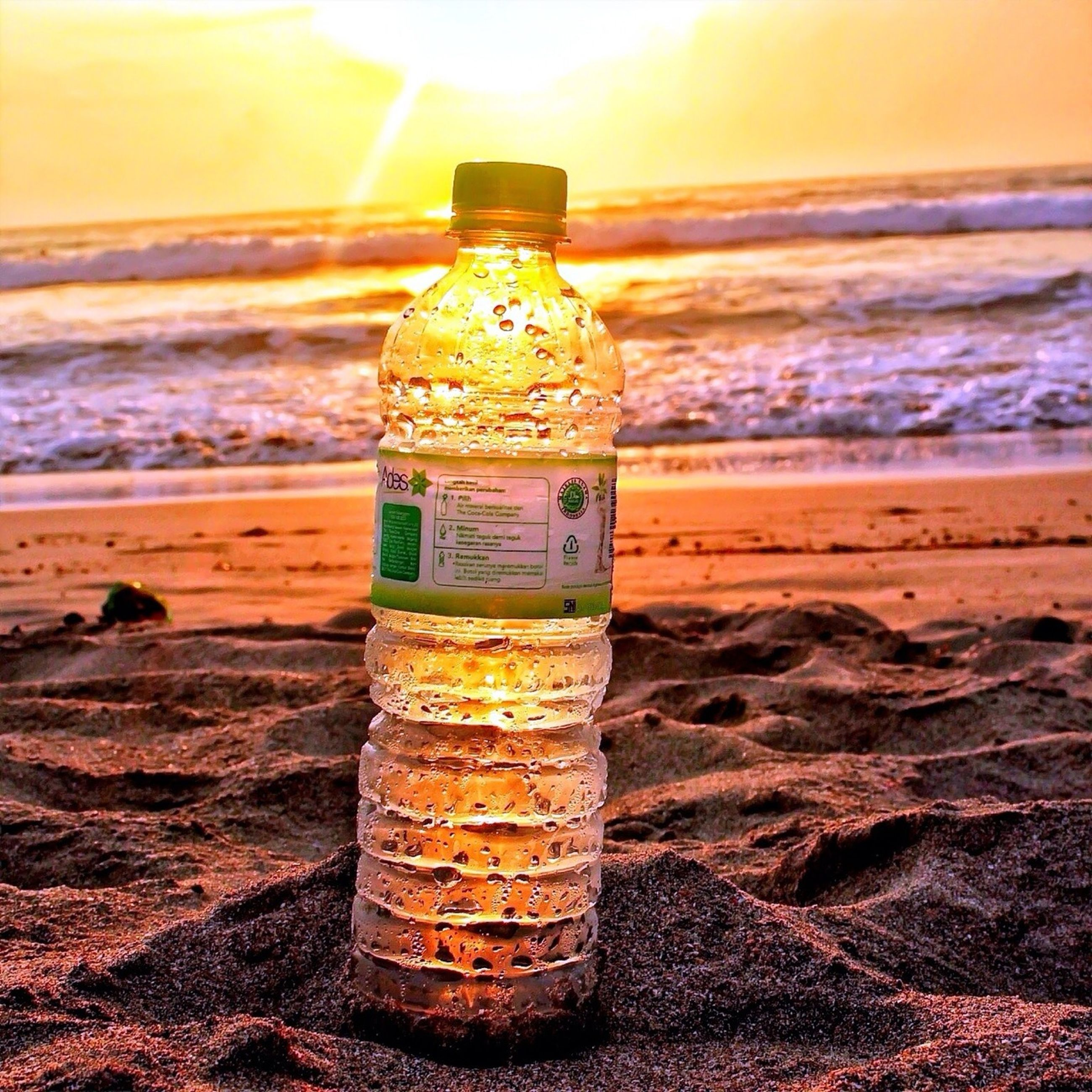 beach, sea, sand, horizon over water, shore, sunset, sunlight, close-up, water, focus on foreground, no people, nature, outdoors, tranquility, sky, scenics, beauty in nature, day, tranquil scene, metal