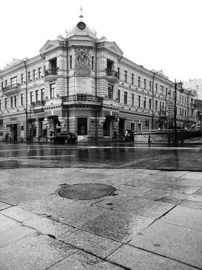 Central crossroad of Vladivostok city City Center City Cityscape City Life City Street Crossroad Architecture Old Buildings Museum In Front Of History Day Façade Footpath Lamp Posts Wet Water Rain Raining Rainy Day Cars Sky August Subway Blac&white