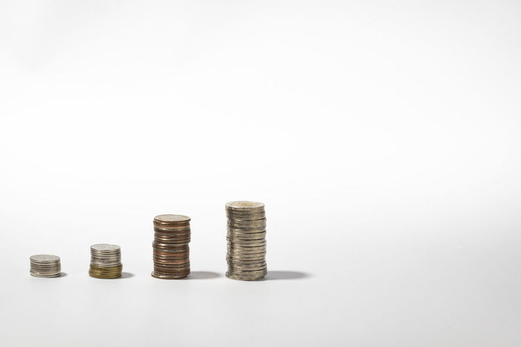 Stack of coin against white background