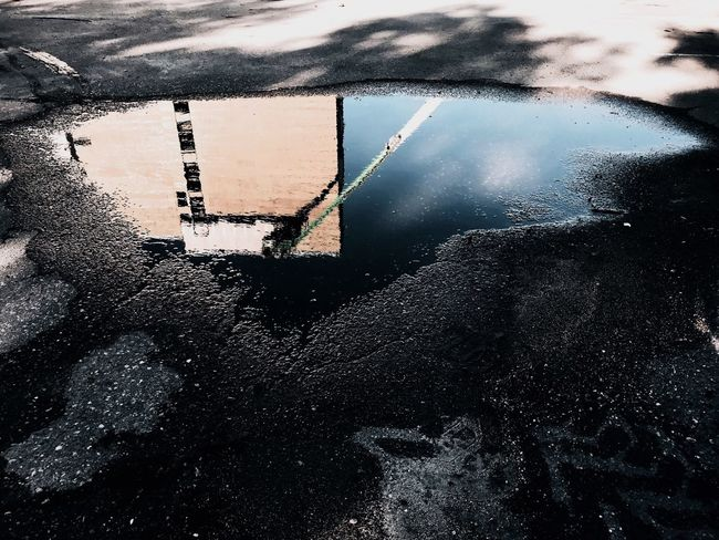 The Street Photographer - 2018 EyeEm Awards The Architect - 2018 EyeEm Awards Water No People Building Exterior Walkway Road Built Structure Wall Shadow Blue Gravel Blacktop Asphalt Pavement Low Angle View Water Reflections Puddle Puddle Reflections Reflections In The Water Construction Construction Site Wet Industry
