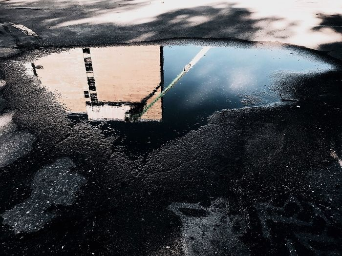 Water No People Building Exterior Walkway Road Built Structure Wall Shadow Blue Gravel Blacktop Asphalt Pavement Low Angle View Water Reflections Puddle Puddle Reflections Reflections In The Water Construction Construction Site Wet Industry Reflection Architecture