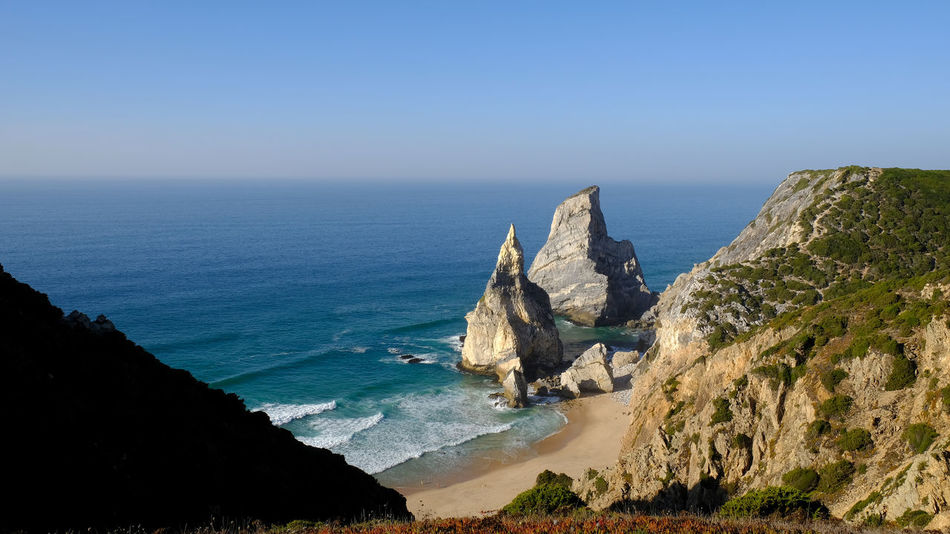 Waves, Ocean, Nature Rock Rock - Object Rock Formation Wave Ursa Beach Ursa Portugal Beauty In Nature Blue Clear Sky Cliff Day Horizon Over Water Nature No People Outdoors Rock - Object Rock Formation Scenics Sea Sky Tranquil Scene Tranquility Water