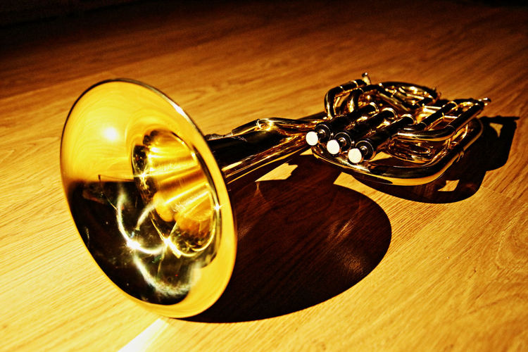 Tenor horn Close Up Gold Colored Horn Music Musical Instrument Single Object Tenor Wooden Floor