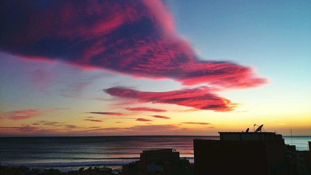 SILHOUETTE BIRD ON BEACH AGAINST SKY AT SUNSET