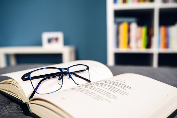 Book Publication Glasses Eyeglasses  Table Education Still Life Indoors  Close-up No People Focus On Foreground Open Bookshelf Paper Literature Personal Accessory Technology Communication Selective Focus Learning Eyewear Studying Reading Glasses