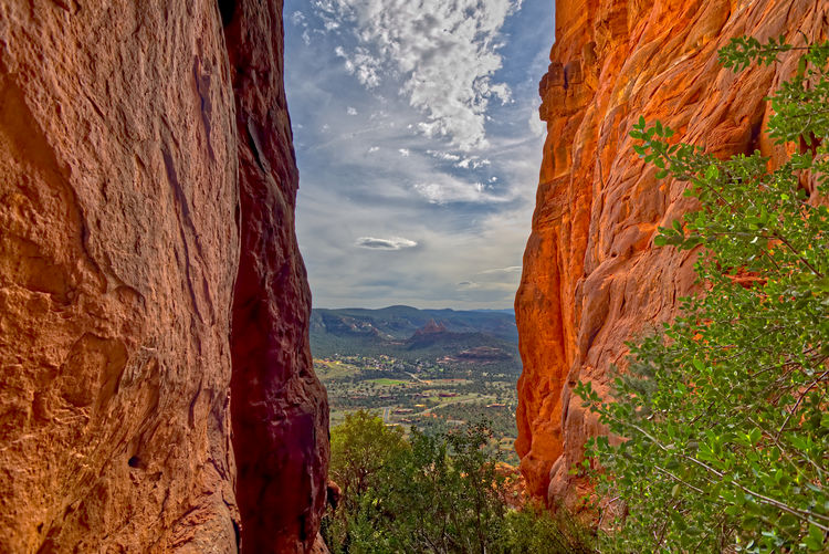 View from within a slot canyon on the south side of Cathedral Rock in Sedona AZ. Mountain Beauty In Nature Mountain Range Scenics - Nature Nature Environment Plant Landscape Tranquil Scene Tranquility Cloud - Sky Non-urban Scene No People Sky Day Land Travel Destinations Rock Formation Tree Rock Outdoors Formation Mountain Peak Arizona Sedona Cathedral Rock
