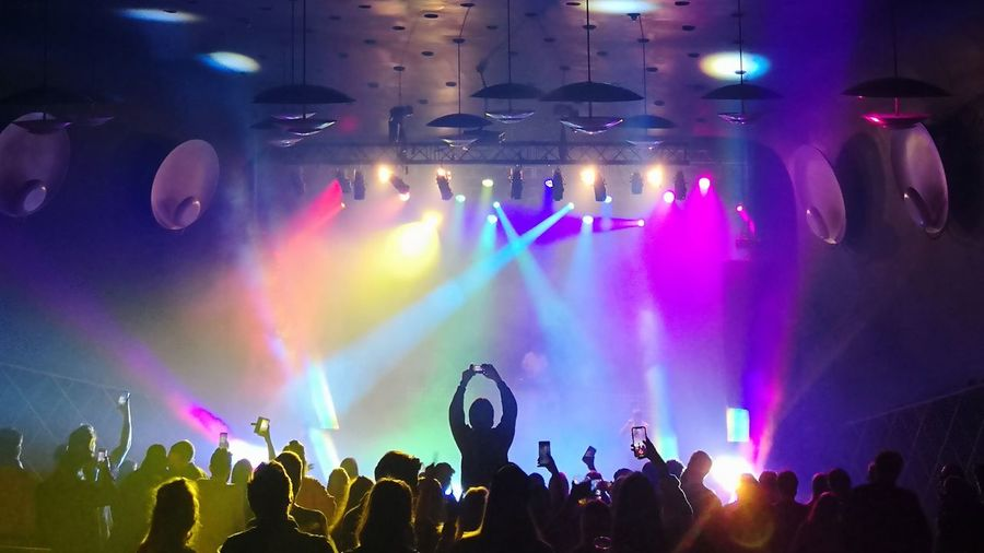 Popular Music Concert Fan - Enthusiast Crowd Audience Human Hand Illuminated Musician Nightlife Youth Culture Stage Light Live Event Entertainment Event Music Festival Dance Music Pop Musician Disco Dancing Concert Pop Music Atmosphere Disco Lights