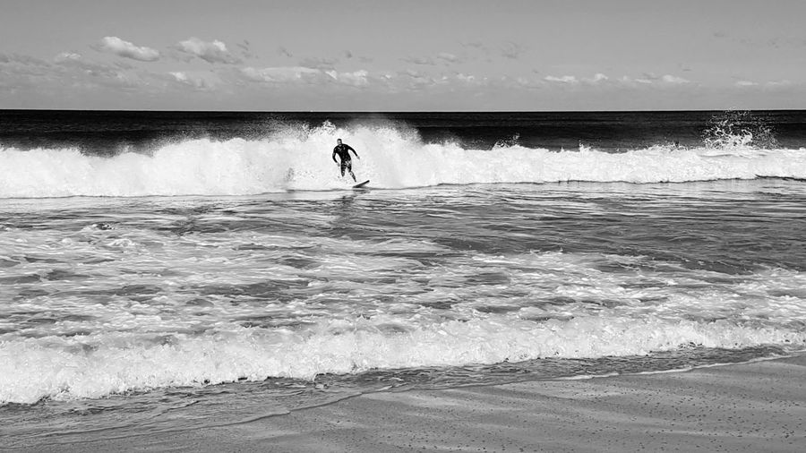 Sea Day Outdoors Sunny One Person Sky Beach Sand Horizon Over Water Aquatic Sport Motion Sport Surfing Wave Water Black And White Photography Blackandwhitephotography Blackandwhitephoto Men Random Acts Of Photography