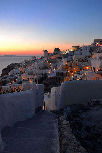 Illuminated Houses At Santorini During Sunset