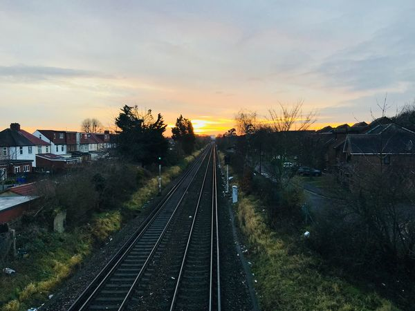 Sunset Scenics Theholysin Tadaa Community Railroad Track Transportation Sky Architecture Built Structure No People Rail Transportation Nature Cloud - Sky Sunset Outdoors High Angle View