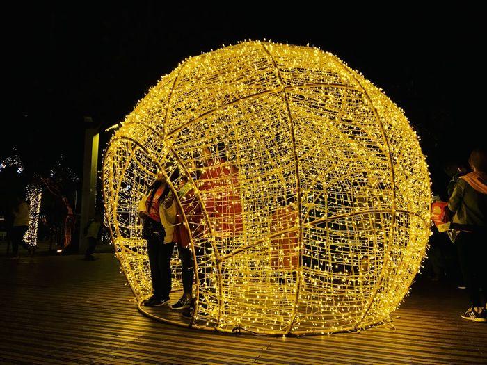 Man with illuminated lighting equipment at night