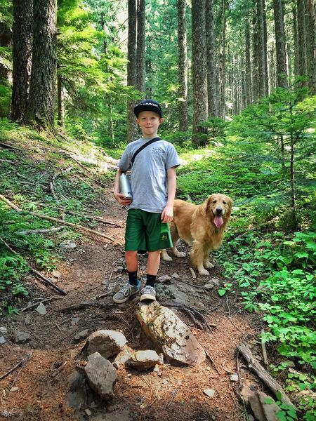Forest Tree Trunk Tree Full Length WoodLand Dog Lifestyles Casual Clothing Looking At Camera Young Men Leisure Activity Person Portrait Non-urban Scene Pets Front View Young Adult My Son ❤ On A Hike Wilderness Woods Outdoors Green Color Beauty In Nature Rooster Rock