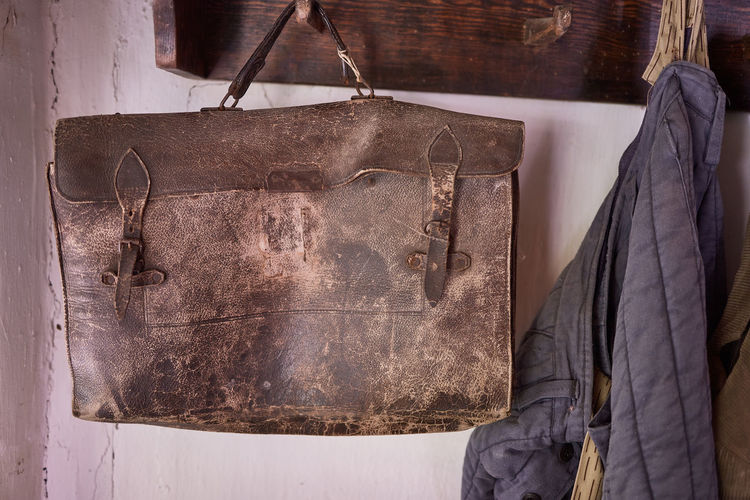 Close-up of clothes hanging on old wall