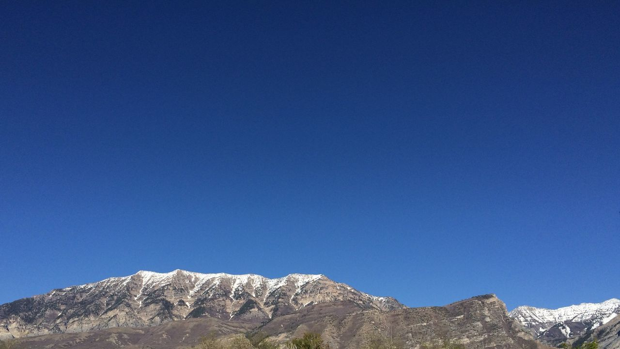 blue, clear sky, nature, copy space, mountain, beauty in nature, low angle view, day, tranquility, no people, outdoors, tranquil scene, scenics, blue sky