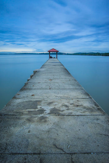 Jetty leading to calm blue sea