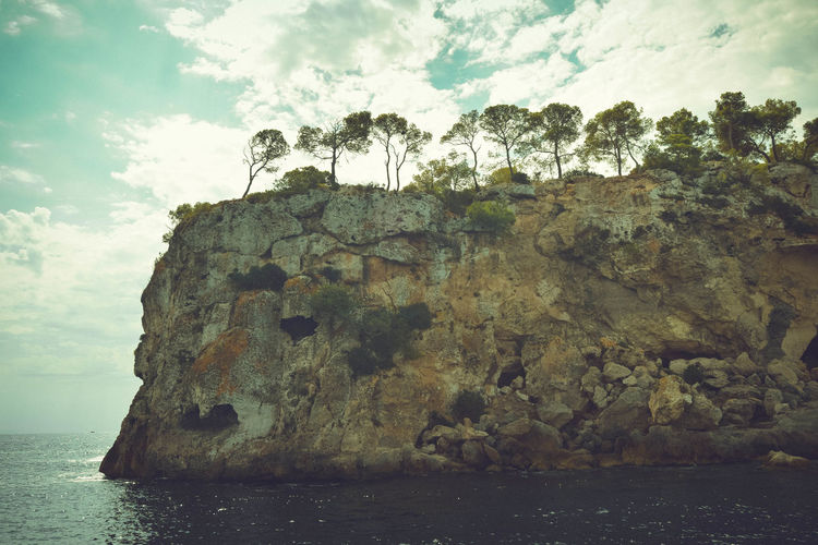 Scenic Beauty In Nature Cliff Cloud - Sky Day Horizon Over Water Landscape Nature No People Outdoors Picturesque Rock - Object Rock Formation Scenics Sea Sea Caves Sky Sunset Tranquil Scene Tranquility Trees On Rock Water
