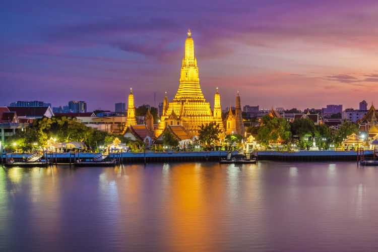 Beautiful view of Wat Arun Temple at twilight in Bangkok, Thailand Bangkok Wat Arun Thailand Temple River Night Beautiful Famous Sunset Travel Twilight City Background Architecture Tourism Landmark ASIA Traditional Culture Religion Cityscape Buddhism Skyline Phraya Ancient Chao Water Boat Religious  Holiday Thai Tower Stupa Sunrise Attraction View Southeast Dusk Oriental Vacations Prang Silhouette East Church Spirituality Chedi Myanmar Chaopraya Shrine