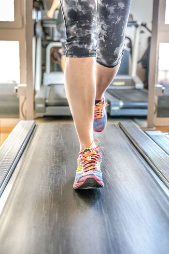 Close up of woman legs in colorful shoes running on treadmill machine in gym. Fast training indoor. Healthy active lifestyle concept. Woman Gym Exercising Females Girl Running Bicips Tapis Roulant Athlete Sport Press Machine Training Trainer Triceps Legs Lifestyles Healthy Biceps Muscles Indoors  One Person Indoors  Healthy Lifestyle Sports Training Human Body Part Shoe Low Section Body Part Human Leg Women Treadmill Exercise Equipment Sports Clothing Adult Day Exercise Machine Effort Human Limb Shorts Self Improvement