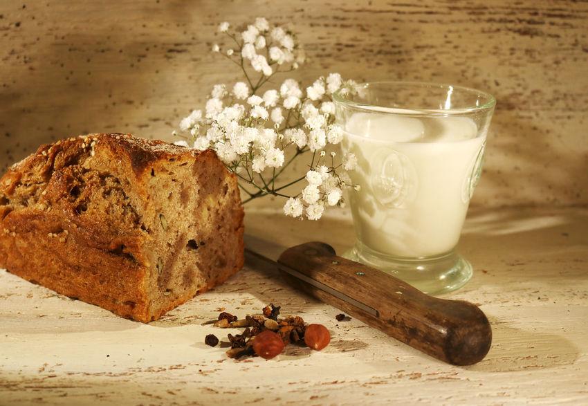 Food And Drink Table Indoors  Still Life Wood - Material Bread Knife Milk Glass Of Milk White Flower Still Life Bread Milk