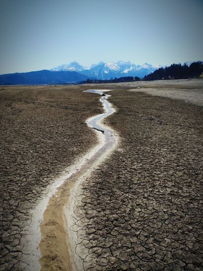 The bottom of the arid Forggenlake and the Alps Approaching From Another View Structures No People Water Mountain Sky Landscape Arid Landscape