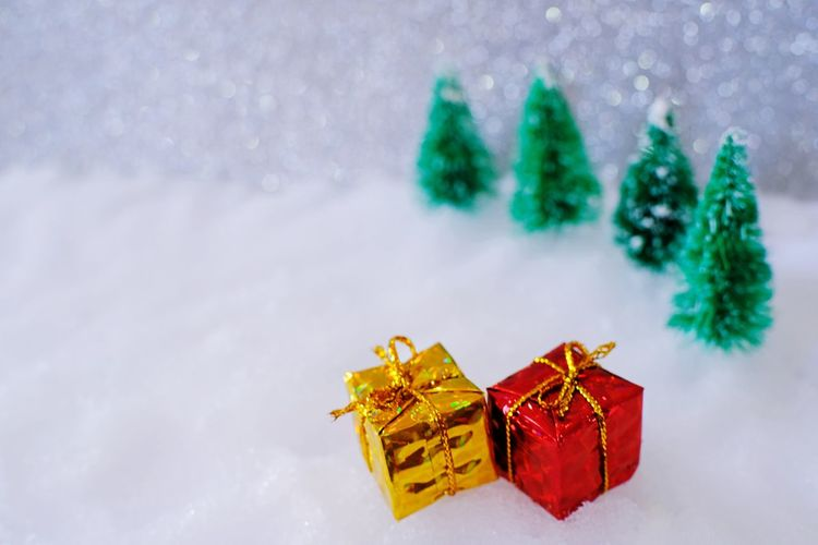 Close-up of small christmas presents on fake snow