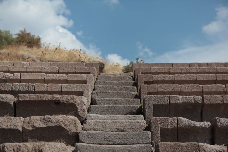 Low angle view of stone steps against sky