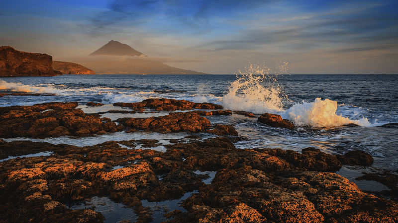 Sunset on Faial Island on the Azores with Mount Pico in the background Coastline Coast Mount Pico Pico Horta Faial Azores Atlantic Ocean Ocean Cloudporn Sky Clouds Dusk Sunset Colour Your Horizn EyeEmNewHere