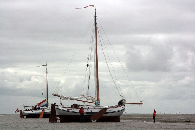 Bottom Of The Sea Ebbe Horizon Over Water Nautical Vessel Sailboat Traditional Sailing Ships Trockenfallen Waiting For High Tid Waiting For The Waterbus