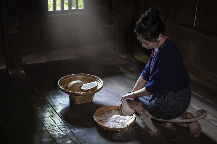 Side view of woman preparing food